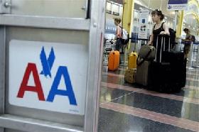 <!--:es-->American Airlines' owner swings to big loss in 2Q<!--:-->