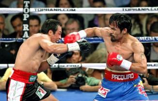 <!--:es-->Robo descarado en Las Vegas: Márquez pierde Ante el descontento del público …Manny Pacquiao retuvo el título welter de la OMB al vencer en cerrado combate, por votación mayoritaria al mexicano.<!--:-->