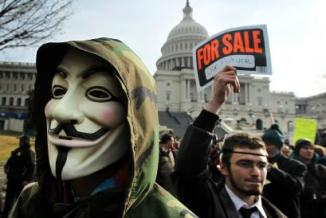 <!--:es-->Several hundred Occupy protesters rally outside Capitol; gathering shows divisions in movement<!--:-->