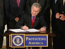 <!--:es-->Bush signs law authorizing harsh interrogation<!--:-->