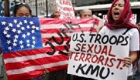 <!--:es-->Philippines charges four US soldiers with rape<!--:-->