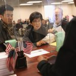 NEWARK, NJ - JANUARY 22:  Immigrants prepare to become American citizens at a naturalization service on January 22, 2018 in Newark, New Jersey. Although much of the federal government was shut down Monday morning, the U.S. Citizenship and Immigration Services (USCIS), offices remained open nationwide.  (Photo by John Moore/Getty Images)